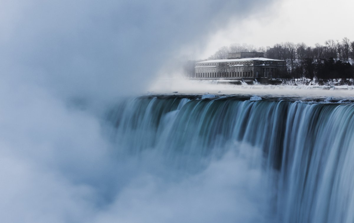 an-old-hydro-building-is-seen-behind-niagara-falls-during-sub-freezing-temperatures-in-niagara-falls-ontario